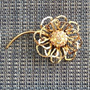 Gold tone flower brooch signed by Sarah Coventry